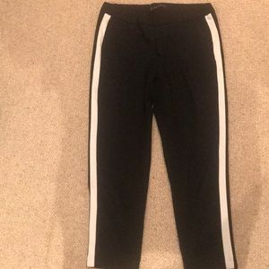 zara pants in black with white stripes on the side